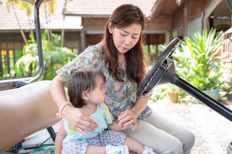 Adult Bonding Brown Hair Casual Clothing Child Childhood Daughter Family Family With One Child Females Front View Girls Hairstyle Innocence Mother Outdoors Parent Three Quarter Length Togetherness Women