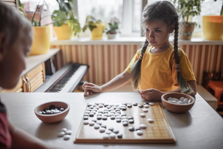 Girl playing on table