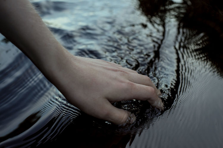 Ceremony Childhood Day Evening Hand Hands Human Body Part Human Hand Life Lifestyles Live Low Section Nature Outdoors Real People Rippled Ritual River Sea Summer Swimming Touch Touching Water Waterfront