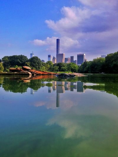 Calm Lake Against Sky At Central Park In City