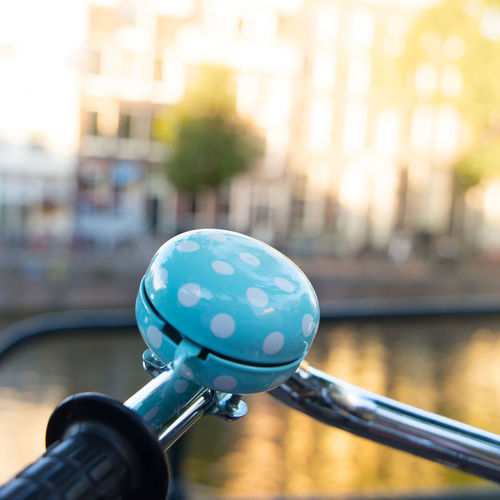 Amsterdam Netherlands Architecture Bicycle Bicycle Bell Building Exterior Built Structure City Close-up Cycling Day Dutch Architecture Dutch Houses Focus On Foreground Handlebar Holland Land Vehicle Metal Mode Of Transportation Nature No People Outdoors Reflection Sphere Spotty Transportation Water