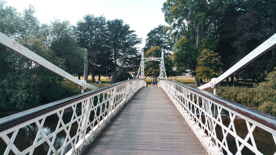 A bridge in Hereford Victorian Old-fashioned Park Park - Man Made Space England White Color British Uk Autumn Fall Tree Footbridge Bridge - Man Made Structure Water Railing Sky Built Structure Rope Bridge Suspension Bridge vanishing point Chain Bridge Engineering Bridge Treelined The Way Forward Empty Road Diminishing Perspective Cable-stayed Bridge