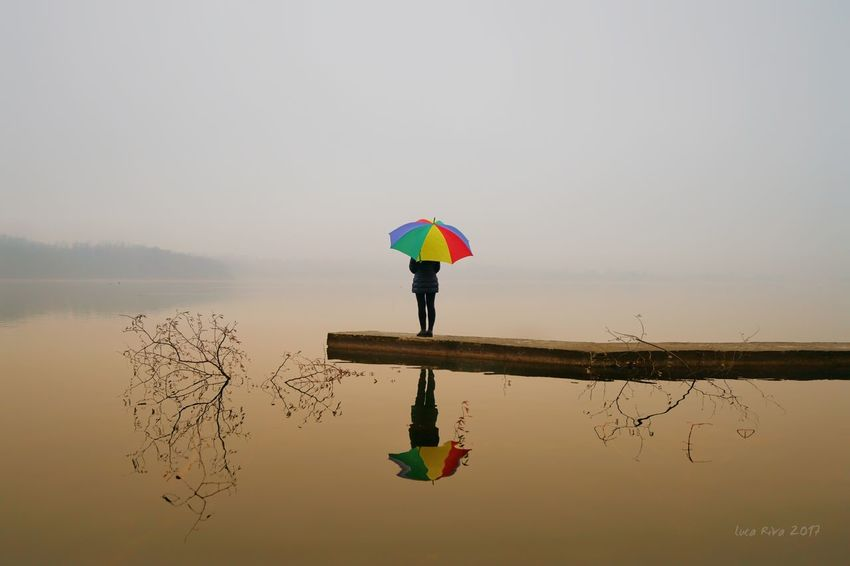colors vs mist Sal24f20z Ombrello Umbrella Themistandthelady A7r2 Sonya7r2 Sonyalpha7 Lucariva Ff Sonya7 Zeiss Zeisslens Lagodiannone Italy Oggiono Water Reflection Rain Full Length One Person Lake Balance Symmetry Sky Outdoors Only Women Standing EyeEm Ready   Fashion Stories