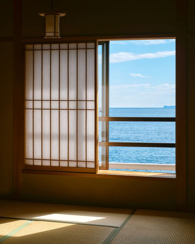 Sea seen through window at home
