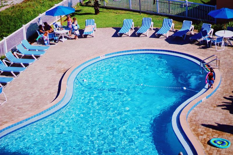 Pool day Group Of People Water Day Lifestyles Real People High Angle View Pool Sunlight Summer Incidental People Leisure Activity Crowd Women Swimming Pool Large Group Of People Nature Blue Men Outdoors Turquoise Colored