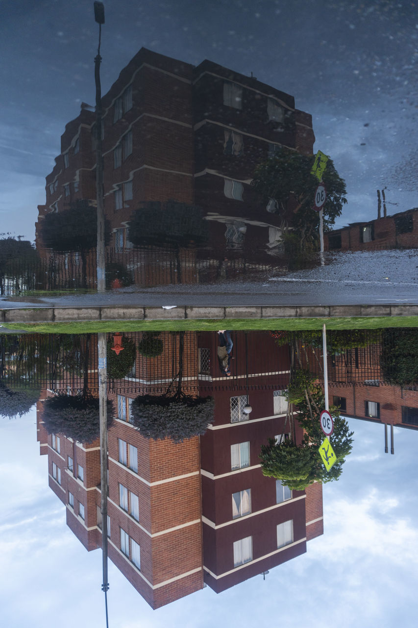REFLECTION OF BUILDING IN PUDDLE ON CANAL