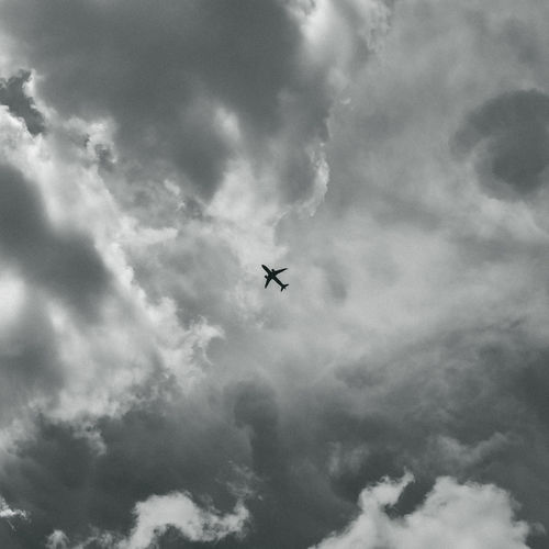 Low angle view of airplane in sky
