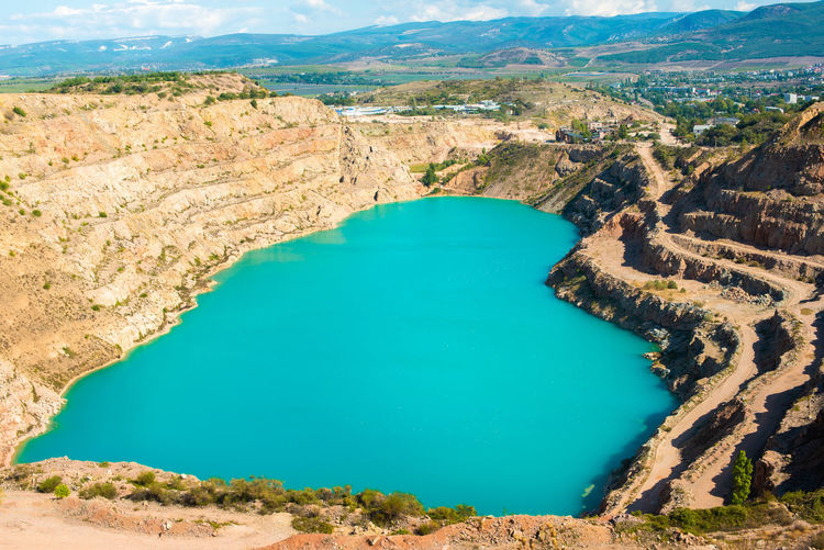 Russia, crimea. turquoise heart-shaped lake. kadykovsky quarry. tourism in summer. in the mountains.