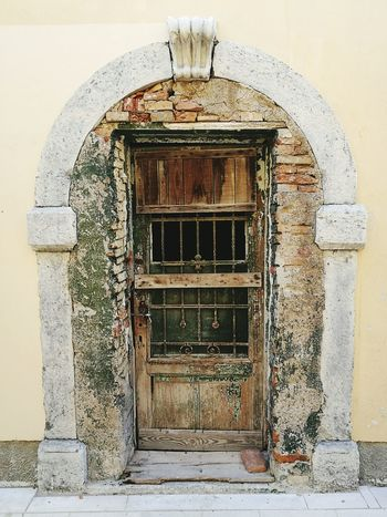 Door Doorway Bricks Wood Shabby Architecture Croatia Croazia Travel Street Photography Textured  City Built Structure History Architecture Building Exterior Travel Destinations Weathered Wood Weathered Aging Beauty Beautiful Paint