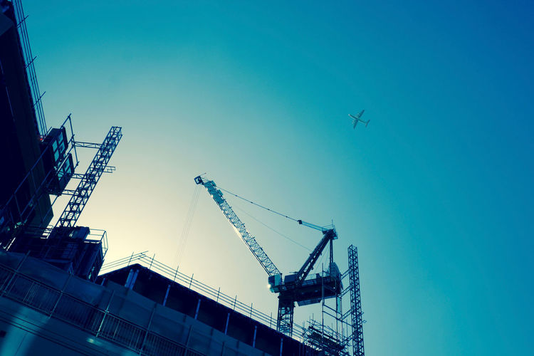 A plane passes over a construction site in The City of London on my walk to St Paul's Cathedral. Airplane City Clear Sky Construction Construction Site Crane Development Engineering Low Angle View Modern