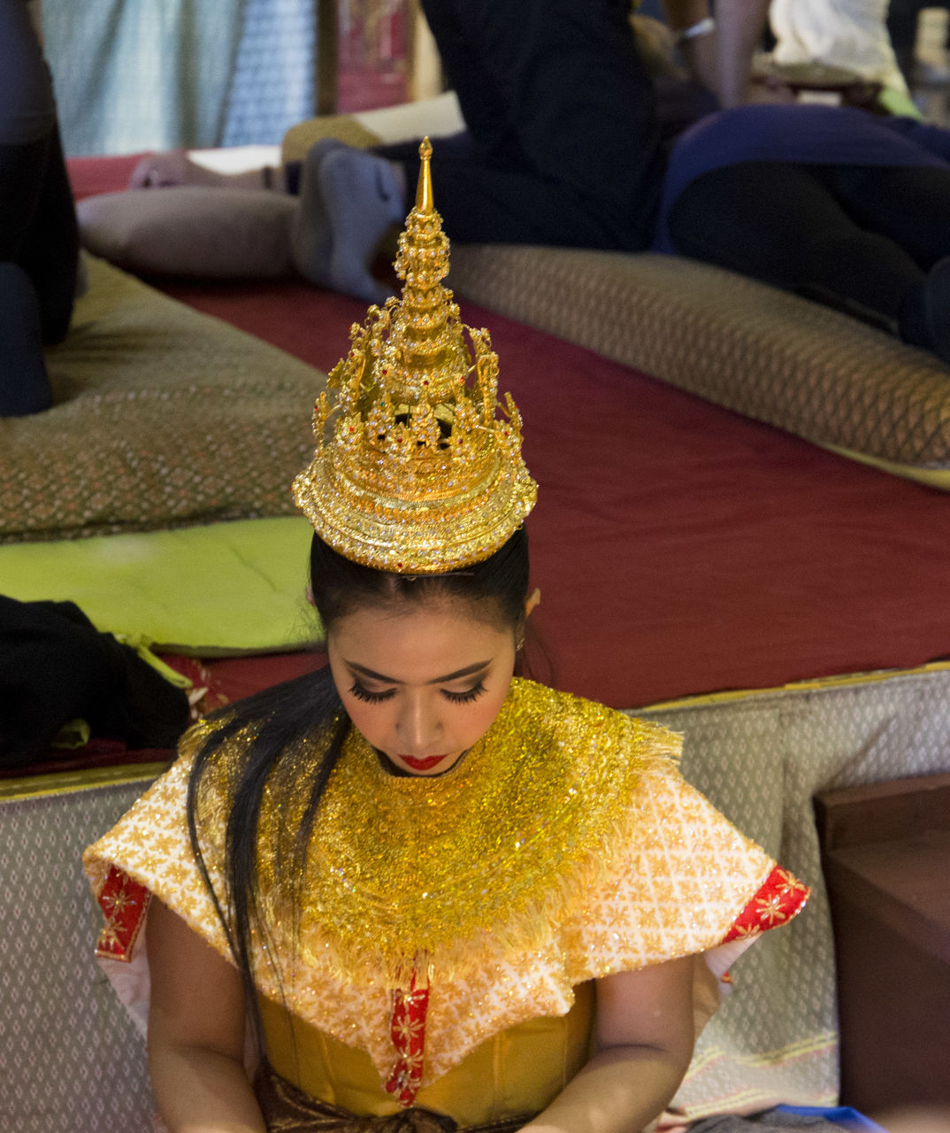 real people, one person, front view, young adult, indoors, lifestyles, traditional clothing, young women, focus on foreground, religion, celebration, spirituality, leisure activity, gold colored, beautiful woman, day, close-up