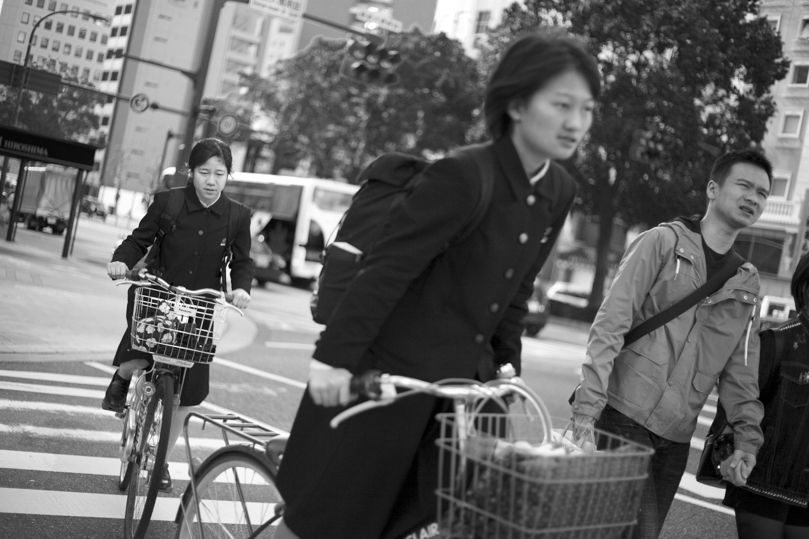 bicycle, city, real people, transportation, adult, men, lifestyles, focus on foreground, casual clothing, street, young adult, architecture, people, women, incidental people, day, mode of transportation, bag, basket, outdoors, riding