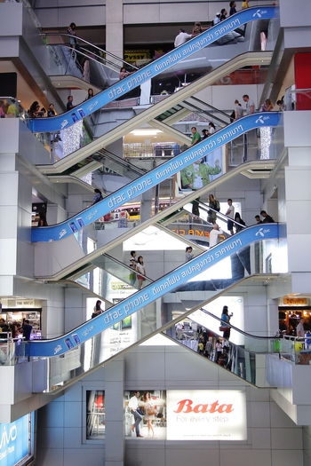 Architecture Bangkok Building Building Exterior Built Structure Ceiling City Day Escalator Escalators High Angle View Incidental People Indoors  Large Group Of People Low Angle View Men Modern Person Railing Repeat Pattern Shopping Mall Staircase Steps Steps And Staircases Thailand