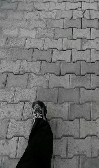 Walking On Road Pavement Footpath Landscape Leg SSClickPics SSClicks Monocrome Photography Monochrome Photography Moving Ahead