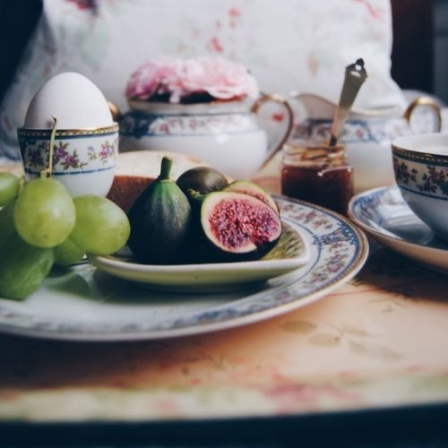 Figs And Grapes With Egg On Plate