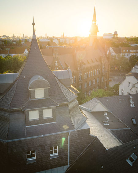 DJI X Eyeem From Above  Historical Building Roof Aerial View Architecture Belief Black Roof Building Building Exterior Built Structure City Cityscape Day Dronephotography Grey Roofs Place Of Worship Religion Spirituality Sun Flare Sunlight Sunrise Sunset Town