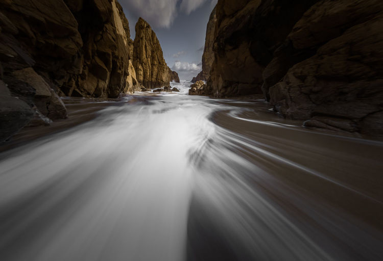 Beauty In Nature Blurred Motion Day Long Exposure Motion Mountain Nature No People Outdoors Physical Geography Rock - Object Scenics Sky Travel Destinations Water Waterfall