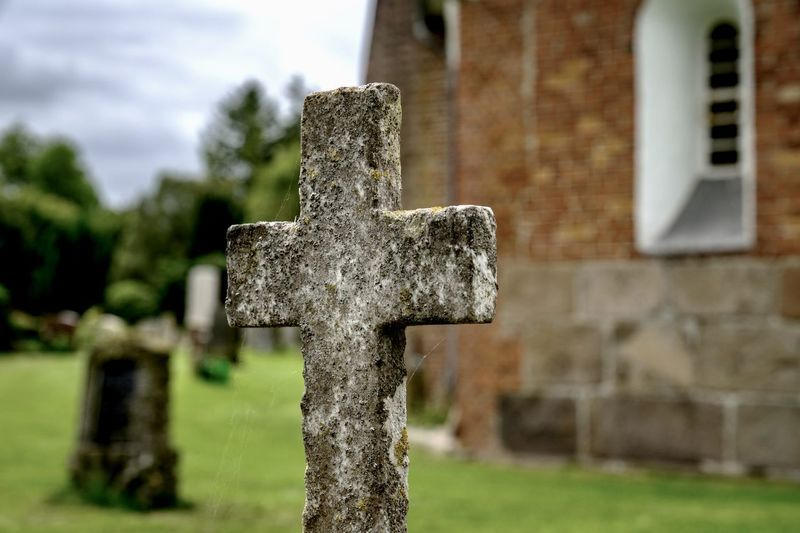 Close-up of old cross in cemetery