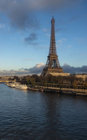 1889 World's Fair Champ De Mars Eiffel Tower Tour Eiffel Architecture Building Exterior Built Structure Cityscape Cultural Icon Day Gustave Eiffel History Lattice Tower Man-made Structure No People Outdoors River Scenics Tourism Tower Travel Travel Destinations Water Waterfront Wrought Iron