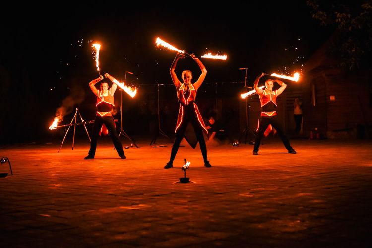 People dancing at music concert at night