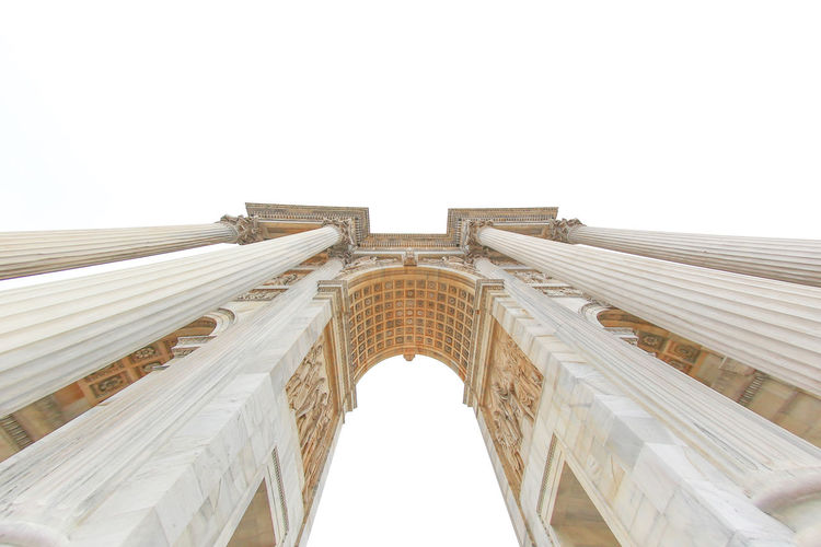 Low angle view of triumphal arch against clear sky