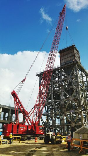 Industrial lifting Crane - Construction Machinery Construction Site Built Structure Outdoors Industry No People Cloud - Sky Development Cranes Steel Structure  Hoisting Rigging Engineering Civil Engineer Field