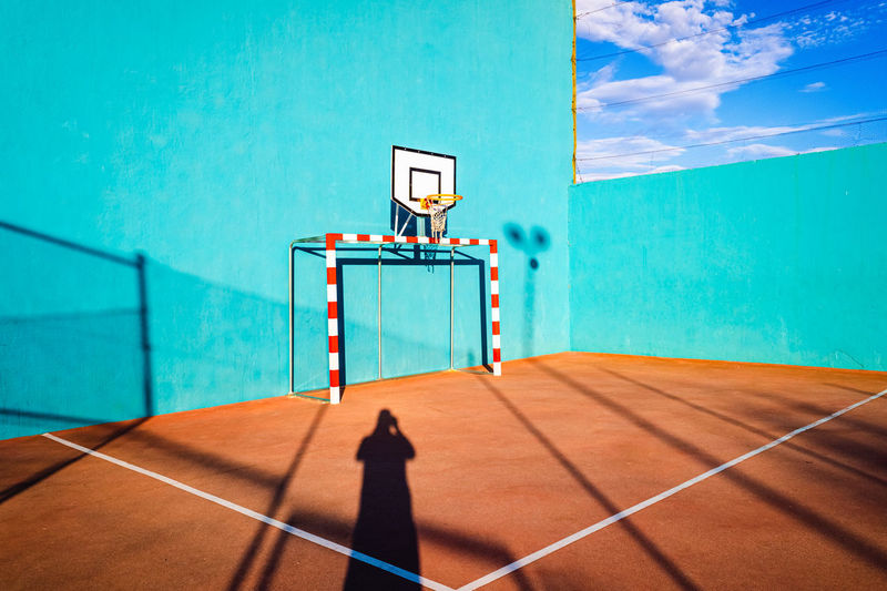 View of basketball hoop against blue sky