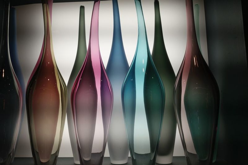 Close-Up Of Multi Colored Creative Bottles On Shelf