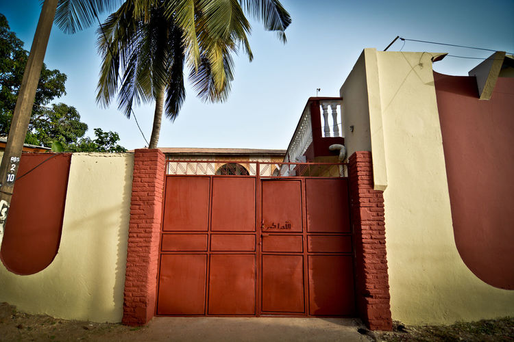A walk through the Bakau neighborhood in The Gambia, West Africa. Africa Concrete Jungle Concrete Wall Doors With Stories Doorswithstories Doorsworldwide Gambia  Gates And Fences Graffiti Graffiti Wall Houses And Homes Thirdworld West Africa