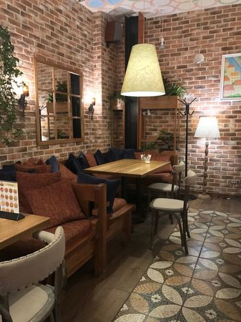 2018 Table Setting Moscow Chilling Relaxing Restaurant Decor Restaurants Restaurant Lighting Equipment Seat Illuminated Chair Brick Electric Lamp Wall Brick Wall Built Structure No People Furniture Architecture Table Home Interior Light
