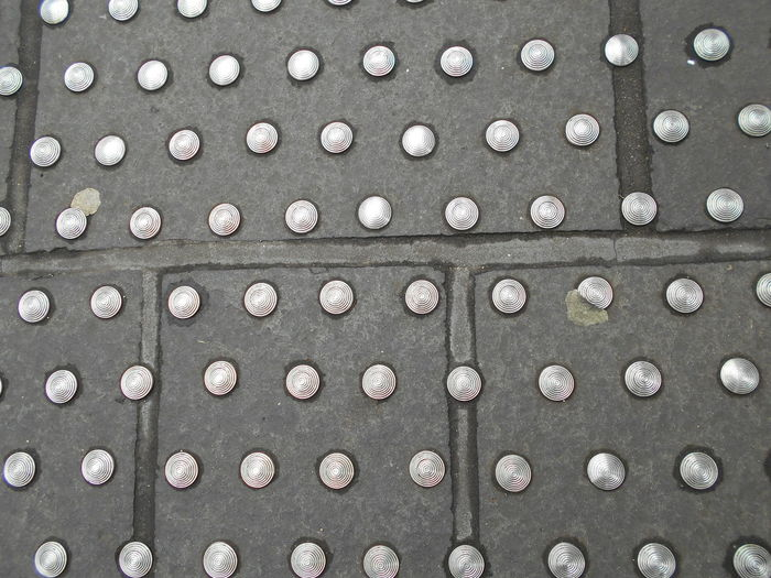 Full frame shot of metal on footpath