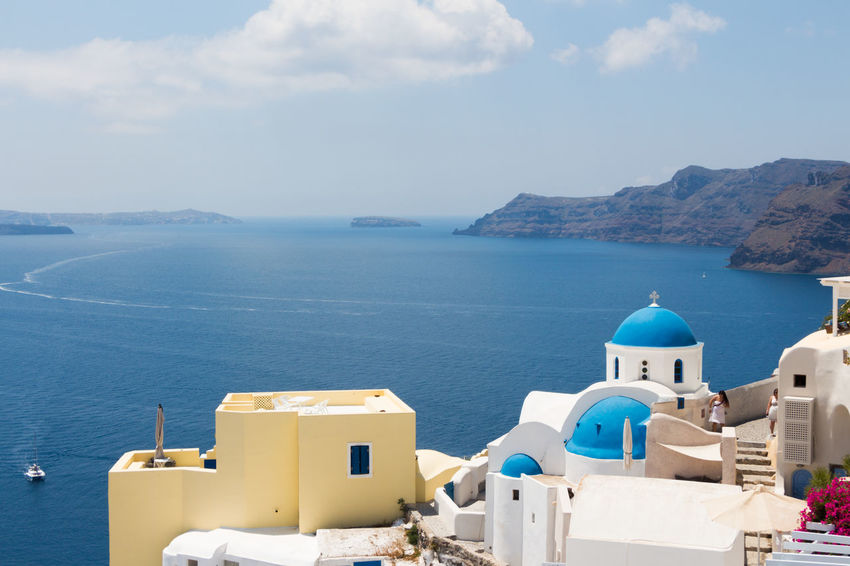 Santorini Architecture Beauty In Nature Blue Building Exterior Built Structure Day Dome High Angle View Horizon Over Water Nature No People Outdoors Place Of Worship Religion Santorini Scenics Sea Sky Spirituality Water Whitewashed