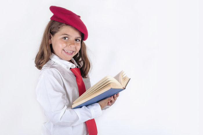 Happiness Happy Innocence Lesson Student Back To School Book Childhood Class Education Expression Genius Girl Happiness Intelligence Learn Portrait School Smile Student Study Textbook White Background