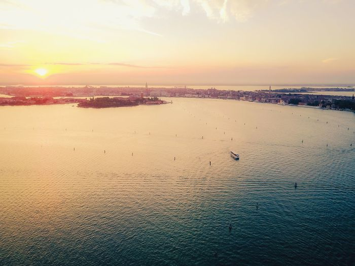 Sunset Water Bird Beauty In Nature Animal Themes Scenics Sea No People Nature Sky Animals In The Wild Built Structure Architecture Outdoors Building Exterior Flying City Day Swan Lost In The Landscape Connected By Travel Drone  Aerial View Venice, Italy Dronephotography The Great Outdoors - 2018 EyeEm Awards