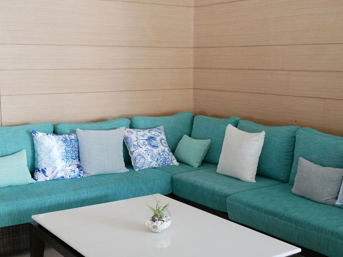 Close-up of sofa on table at hotel