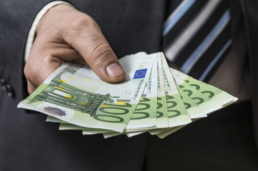 Businessman in grey suit giving euros, shallow depth of field Loan  Payout Rich Salary Suit Work Business Businessman Buying Cash Currency Deal Euro Finance Giving Hand Holding Investment Making Money Men Money Paying Success Wage Wealth