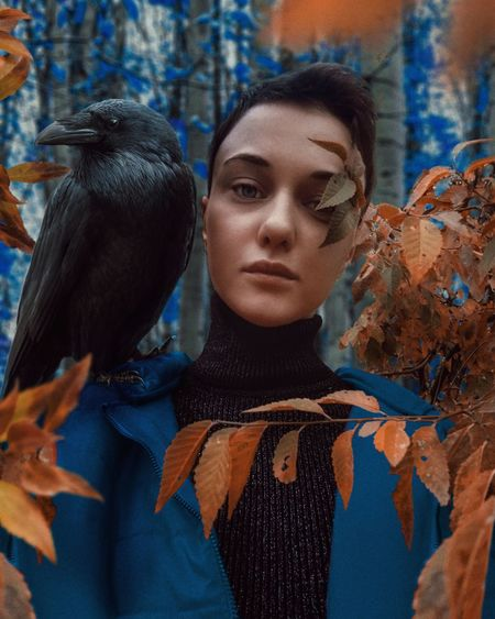 Portrait of woman looking at birds