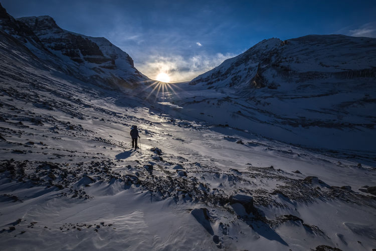 Sunset traverse up to the Athabasca Glacier. Life it seams is most precious in the quiet meditative space between destinations. The journey needs to be serene as the destination is ultimately fleeting. Jasper National Park, Alberta, Canada Love Life, Love Photography Alberta Athabasca Beauty In Nature Canada Cold Cold Temperature Glacier Ice Jasper Adventure Mountain Range Mountains National Park Person Rock Scenics Sky Snow Snowcapped Mountain Snowshoe Sun Sunset Sunstars Weather Winter The Great Outdoors Breathing Space Connected By Travel Perspectives On Nature Be. Ready. Perspectives On Nature