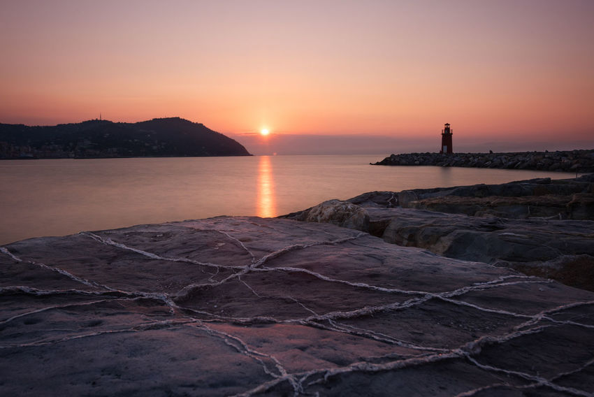 Calm EyeEm Best Shots EyeEmbestshots First Sunlight Leading Lines Lighthouse Morning Light Rock Landscape Long Exposure Ocean Orange Color Rock Sun Sunrise Warm Colors Water