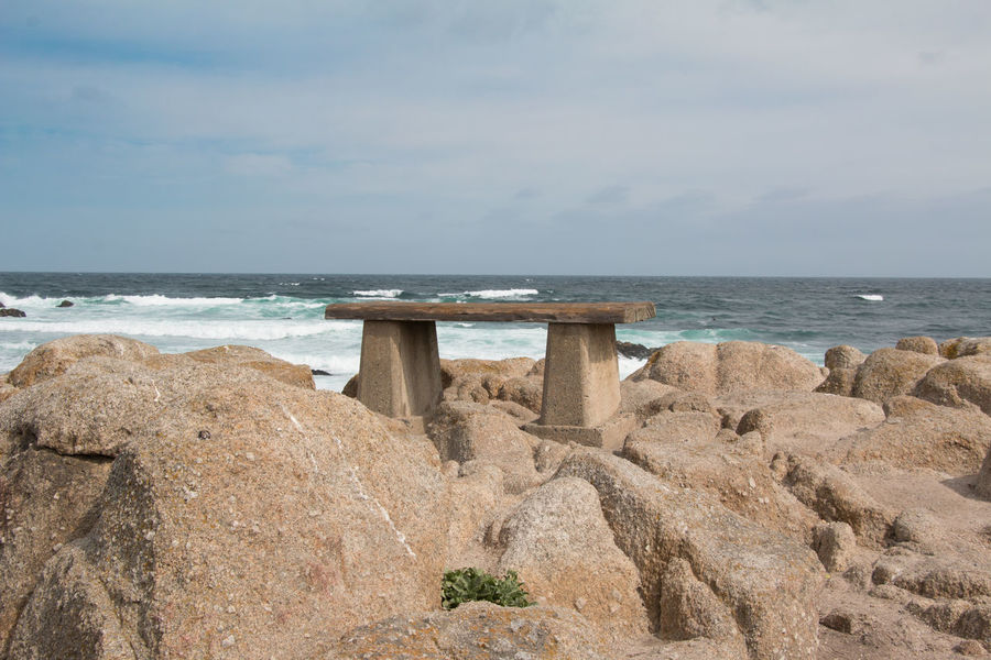 Bench on rocky ocean Bench Nature Picturesque Scenery Travel Idyllic Scenery Landscape Leisure Ocean Rocks Seascape Seaside