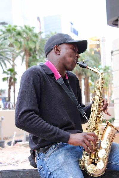Art Is Everywhere Freeze Frame Day Music Musical Instrument Musician Saxophone Playing Arts Culture And Entertainment Performance Jazz Music Outdoors Real People Lifestyles One Person Hat Young Adult Las Vegas Street Performer
