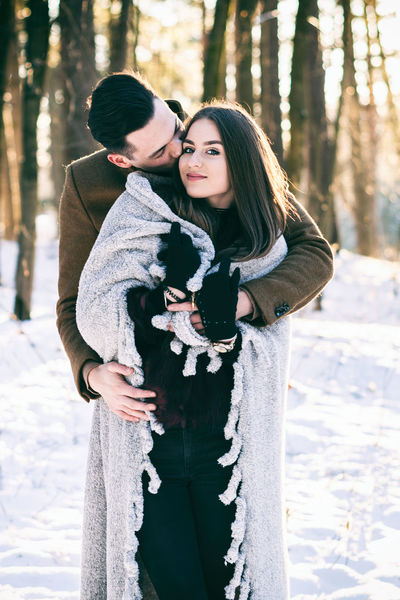 Beautiful People Beauty Beauty In Nature Christmas City Cold Temperature Couple - Relationship Dating Embracing Flirting Happiness Lifestyles Love People Romance Snow Togetherness Two People Valentine's Day - Holiday Warm Clothing Winter Women Young Adult Young Women