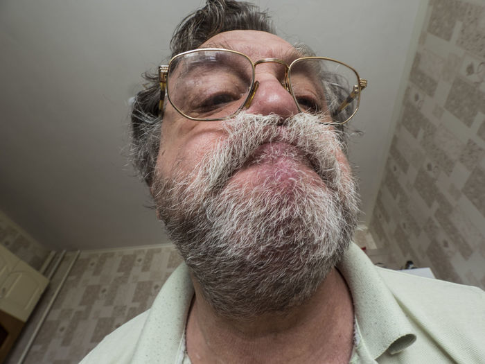 Funny photo of Unshaven man Adult Adults Only Beard Close-up Eyeglasses  Eyes Closed  Facial Hair Funny Gray Background Hair Loss Human Body Part Human Face Lifestyles Mature Adult Mature Men Men One Man Only One Mature Man Only One Person Only Men People Portrait Real People Senior Adult Unshaven