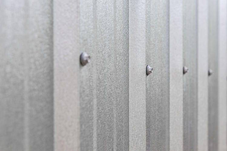 metal sheet texture background No People Security Protection Pattern Safety Full Frame Metal Close-up Backgrounds Entrance Textured  Wall - Building Feature Architecture Selective Focus Door Built Structure Silver Colored Sheet Day In A Row Boundary Barrier Outdoors Iron - Metal Concrete