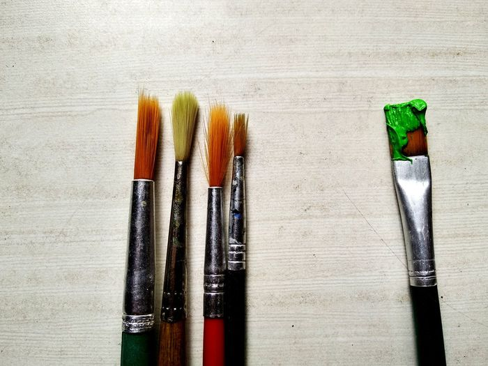 Directly above shot of paintbrushes on table
