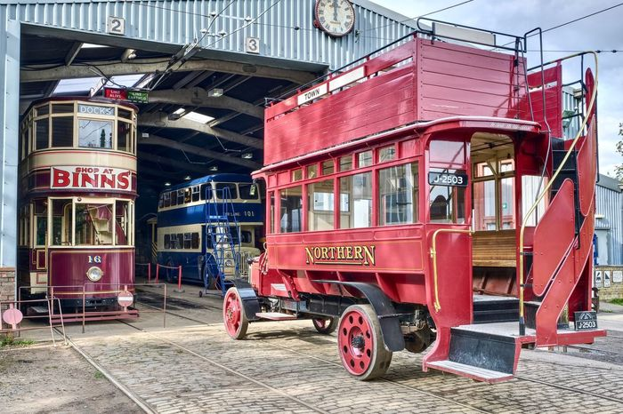 Vintage tram and bus depot at Beamish Museum, Stanley, County Durham Tram Transportation Bus Museum Old Open Top Red Tourism Tramway Vintage
