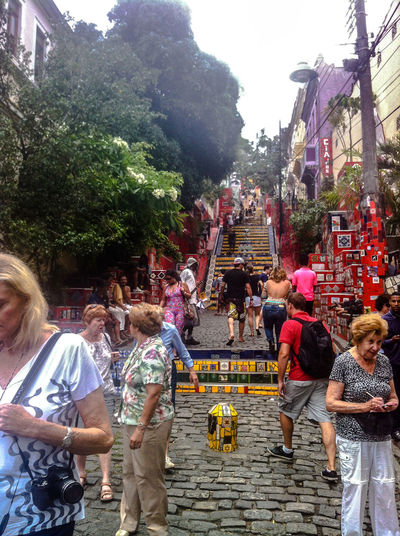 November 2014. Brazil! Saudades... Celebration Crowd Cultures Day Fun IPhone 4 IPhoneography Large Group Of People Leisure Activity Lifestyles Men Mixed Age Range Occupation Outdoors Real People Religion Sitting Street Togetherness Women
