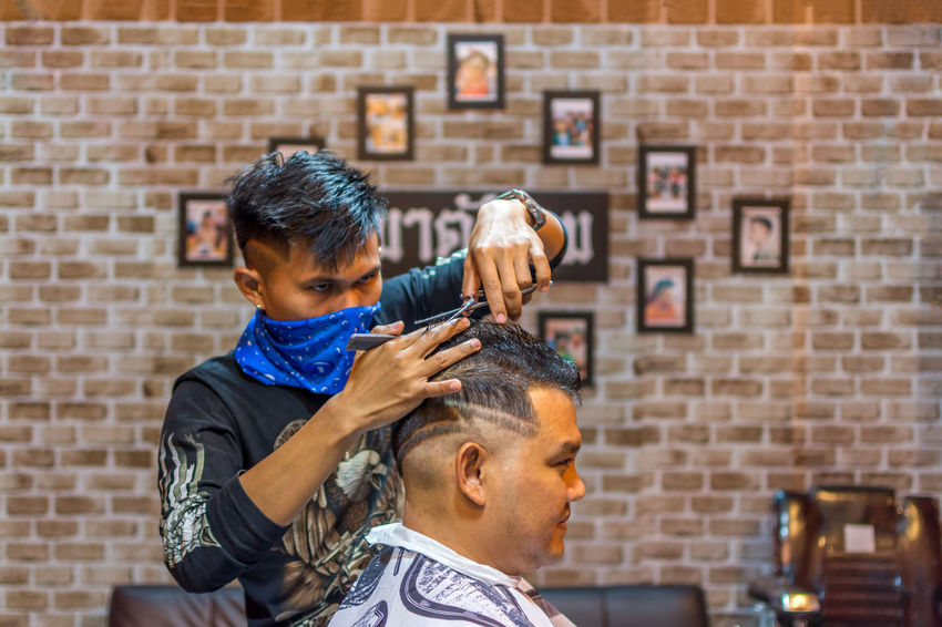 Adult Barber Barber Shop Body Care Boys Child Combing Customer  Cutting Cutting Hair Hair Care Hair Salon Hairbrush Hairdresser Hairstyle Human Hair Indoors  Lifestyles Males  Men Occupation Scissors Small Business Two People Working