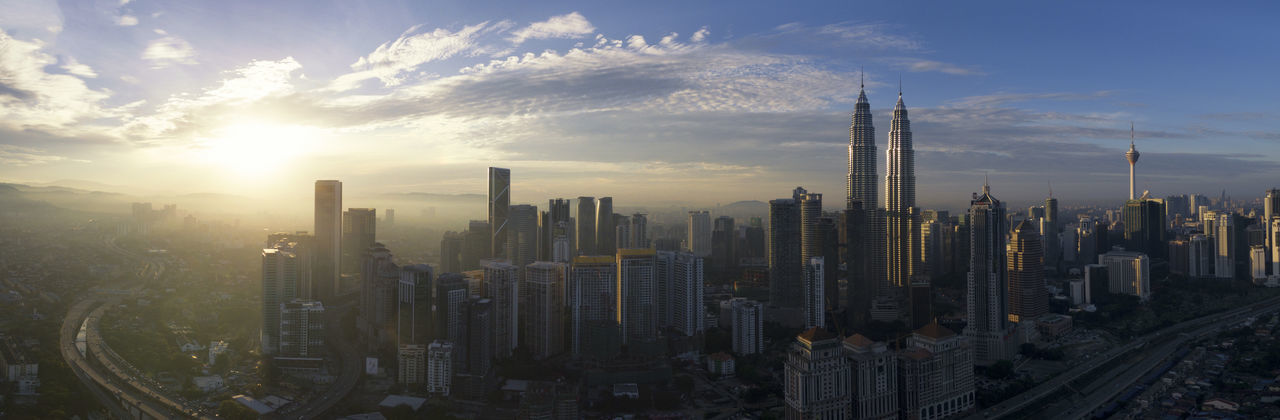 Aerial view sunrise of cityscape Kuala Lumpur Aerial Panoromic Cityscape Modern Architecture Panoramic View Sunrise_Collection Tourist Attraction  Aerial View Architecture Building Exterior Built Structure City Day Destination Traveling Modern Outdoors Panoromic Sky Skyscraper Tower Travel Destinations Urban Skyline