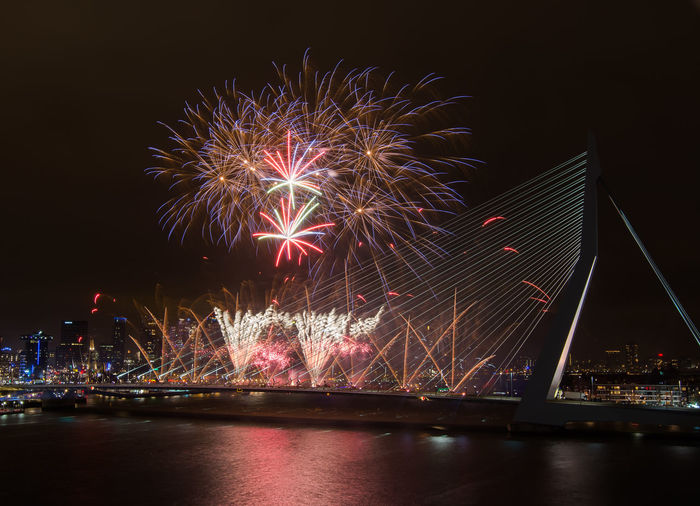 Firework Exploding Over Erasmus Bridge At Night